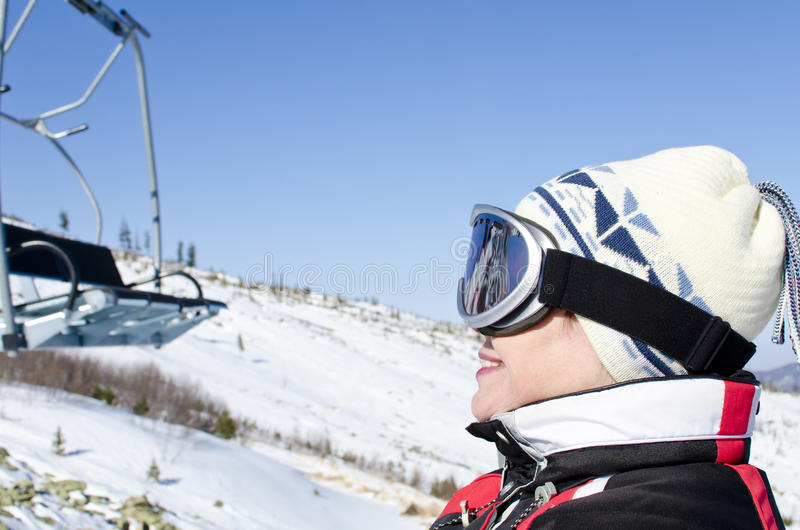 Portrait of a woman alpine skier royalty free stock photo