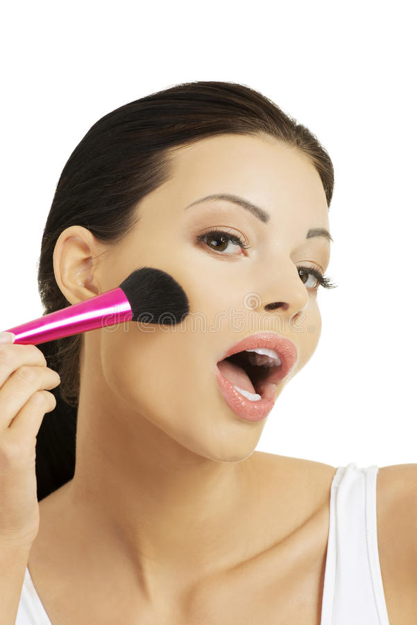 Portrait of a woman applying make up royalty free stock photography