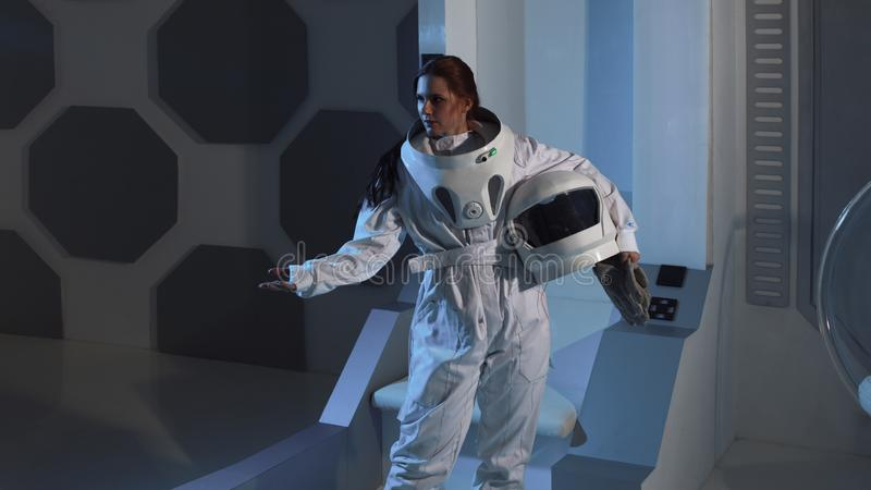 Portrait of a woman astronaut in a space suit on a spaceship. Science fiction concept stock photography