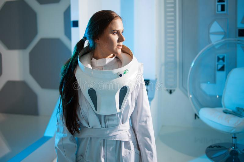 Portrait of a woman astronaut in a space suit on a spaceship. Science fiction concept royalty free stock photography