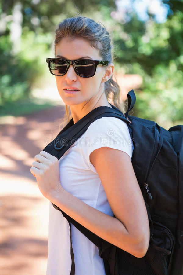 Portrait of woman with backpack stock photo