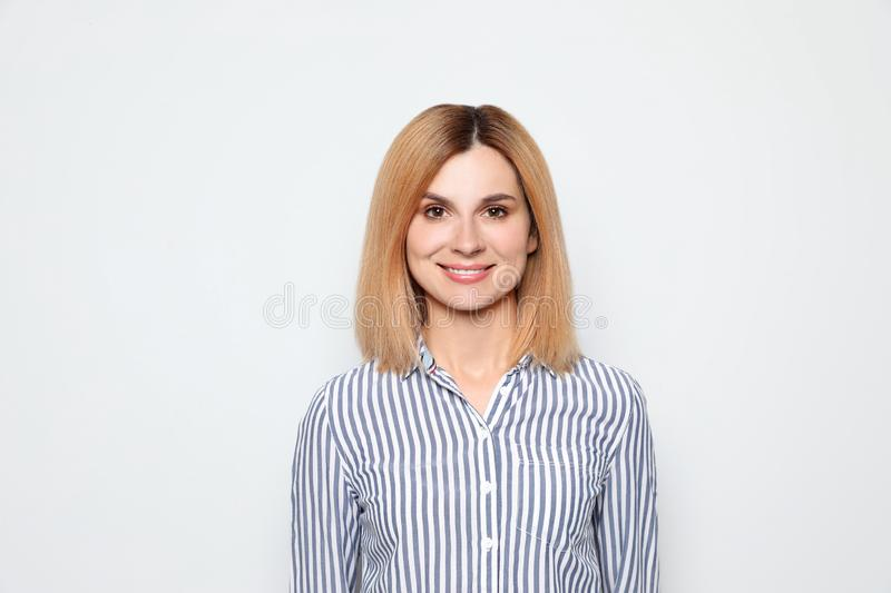 Portrait of woman with beautiful face on white royalty free stock photography