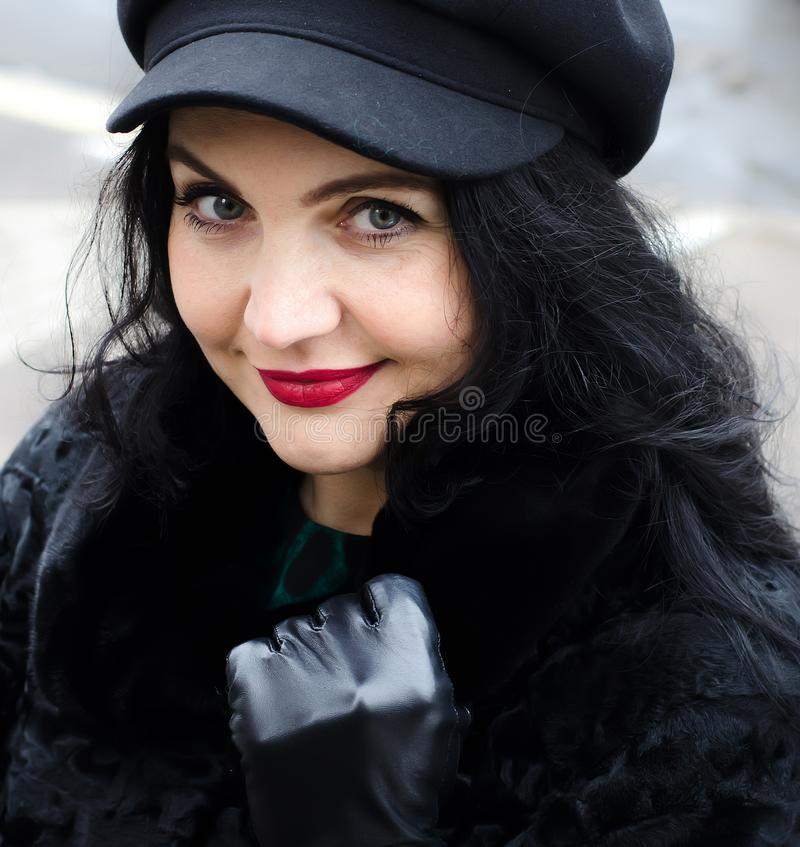Portrait of a woman. Beautiful fashionable woman in the street. stock photography