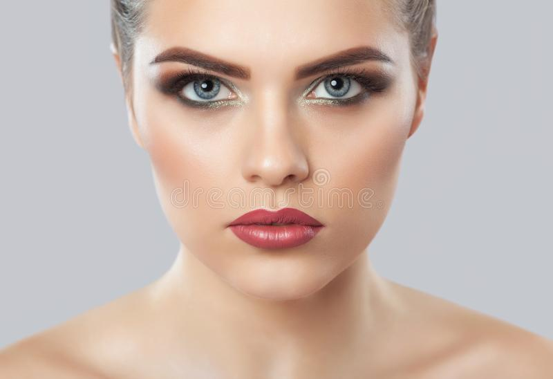 Portrait of a woman with beautiful make-up. Professional makeup and skin care stock images