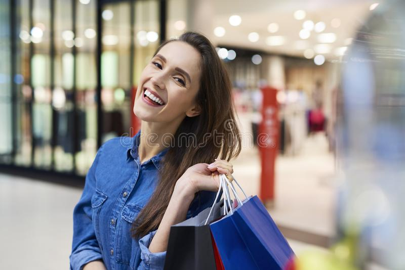 Portrait of woman with big smile on her face after big shopping royalty free stock images