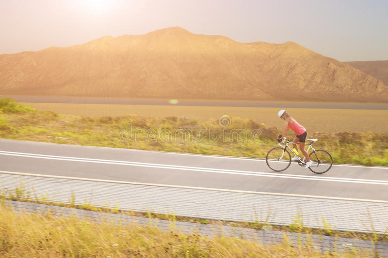Download Portrait Of A Woman On Bike Near The Mountains Royalty Free Stock Image - Image: 33042836