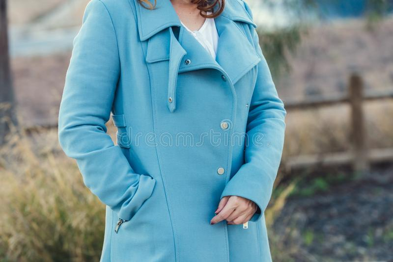 Woman with black coat stock photography