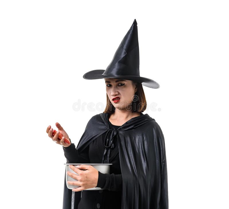 Portrait of woman in black Scary witch halloween costume standing with hat isolated on white background. Woman in black Scary witch halloween costume standing stock image
