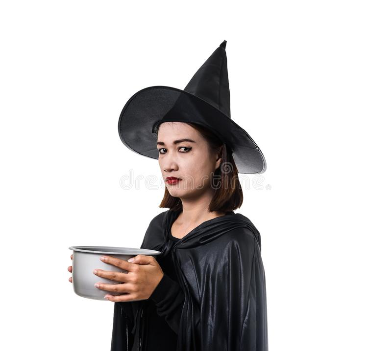 Portrait of woman in black Scary witch halloween costume standing with hat isolated on white background. Portrait of woman in black Scary witch halloween costume stock photo
