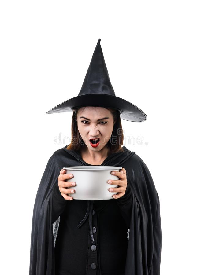 Portrait of woman in black Scary witch halloween costume standing with hat isolated on white background. Portrait of woman in black Scary witch halloween costume stock images