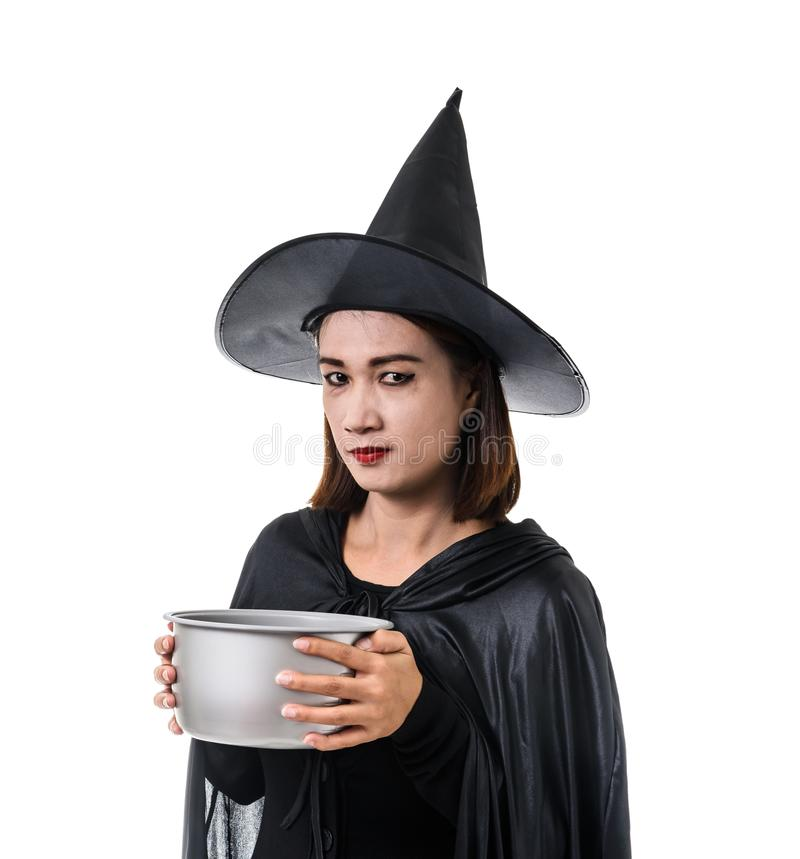 Portrait of woman in black Scary witch halloween costume standing with hat isolated on white background. Portrait of woman in black Scary witch halloween costume stock image