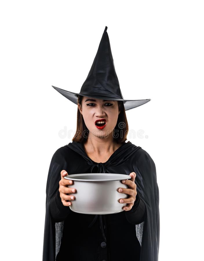 Portrait of woman in black Scary witch halloween costume standing with hat isolated on white background. Portrait of woman in black Scary witch halloween costume stock photos