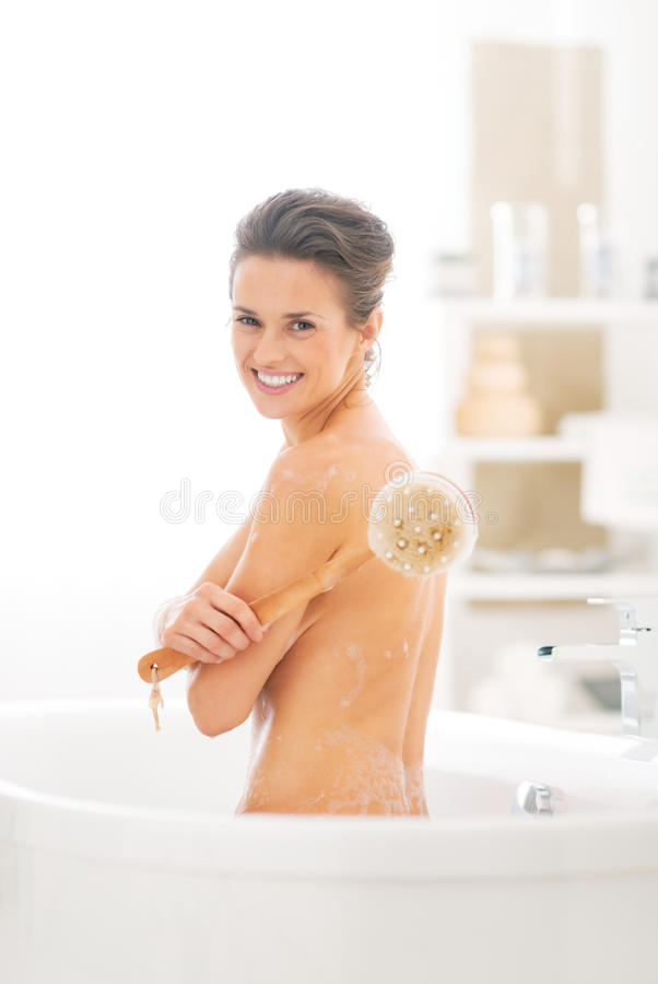 Download Portrait Of  Woman With Body Brush In Bathtub Stock Image - Image: 41761979