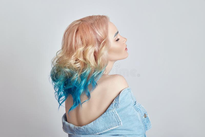 Portrait woman with bright colored flying hair, all shades purple blue. Hair coloring, beautiful lips and makeup. Hair fluttering royalty free stock photos