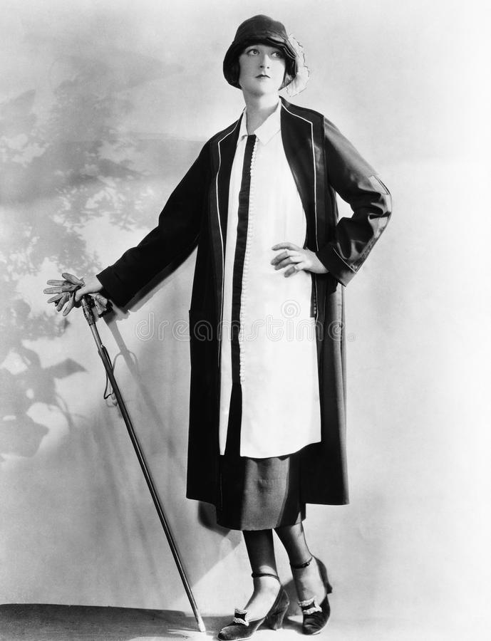 Portrait of woman with cane and gloves stock image