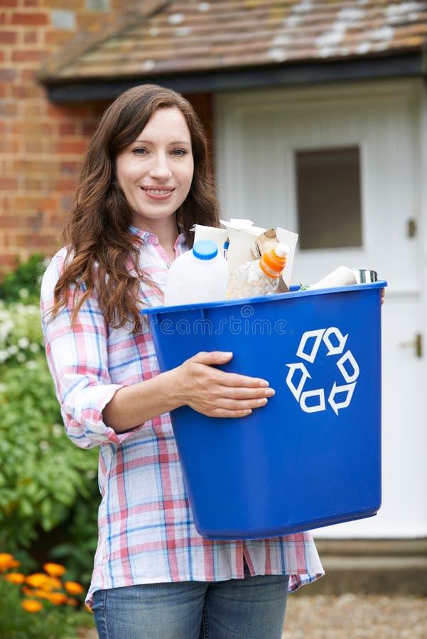 Portrait Of Woman Carrying Recycling Bin stock photos