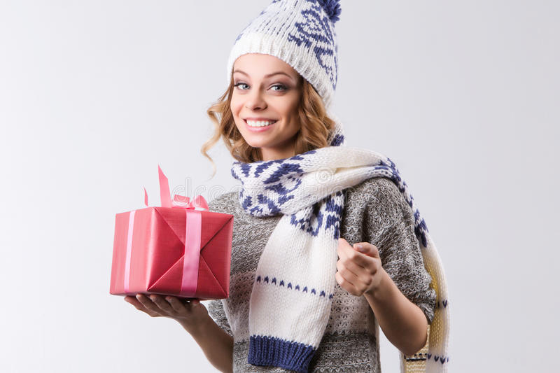 Portrait woman celebrating Xmas and Happy New year. Happy smiling girl with gift box royalty free stock photography