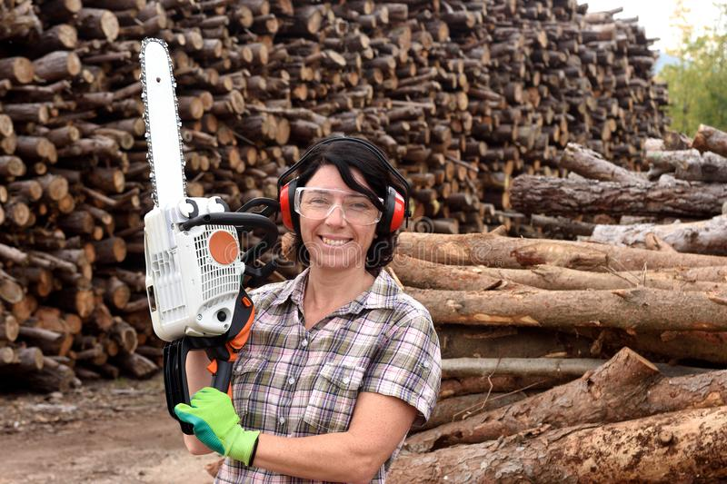 Portrait of a woman with a chainsaw stock image