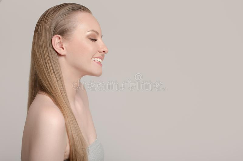 Portrait of a woman with clean skin and white straight hair. Pretty woman smiles royalty free stock image