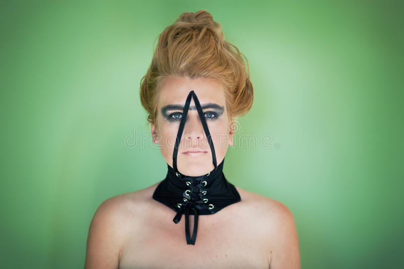 Portrait of woman with collar stock photos
