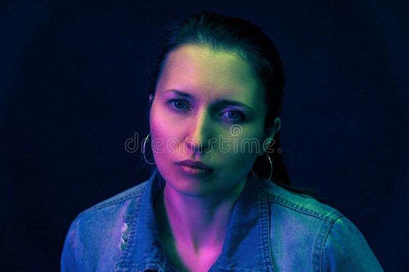 Portrait of a woman and the color filter color mixed light stock image