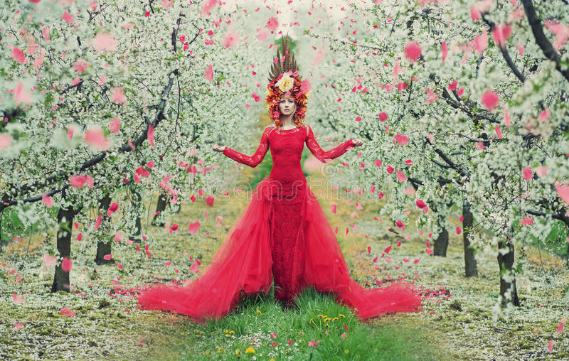 Portrait of the woman in the colorful orchard stock images