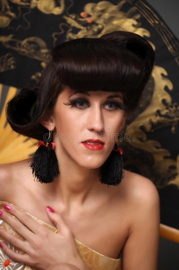 Portrait of a woman with a creative oriental hairdo and long ey royalty free stock photos