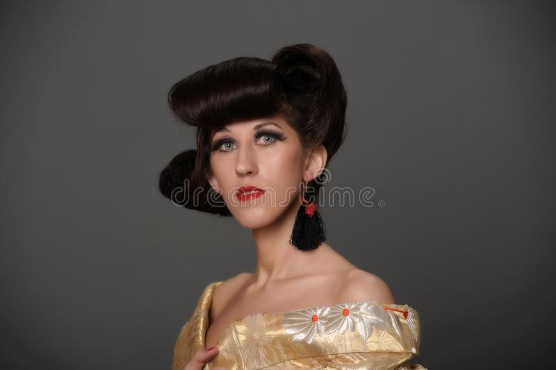 Portrait of a woman with a creative oriental hairdo and long ey stock photo