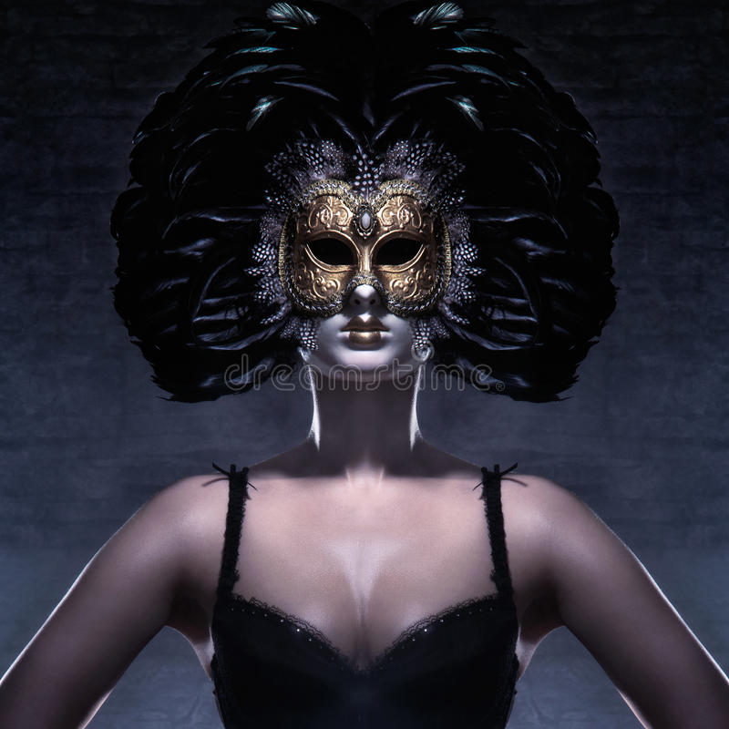 Portrait of a woman in a dark Venetian mask