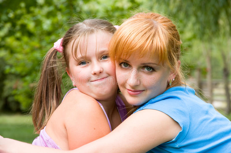 Portrait of woman with daughter royalty free stock photo
