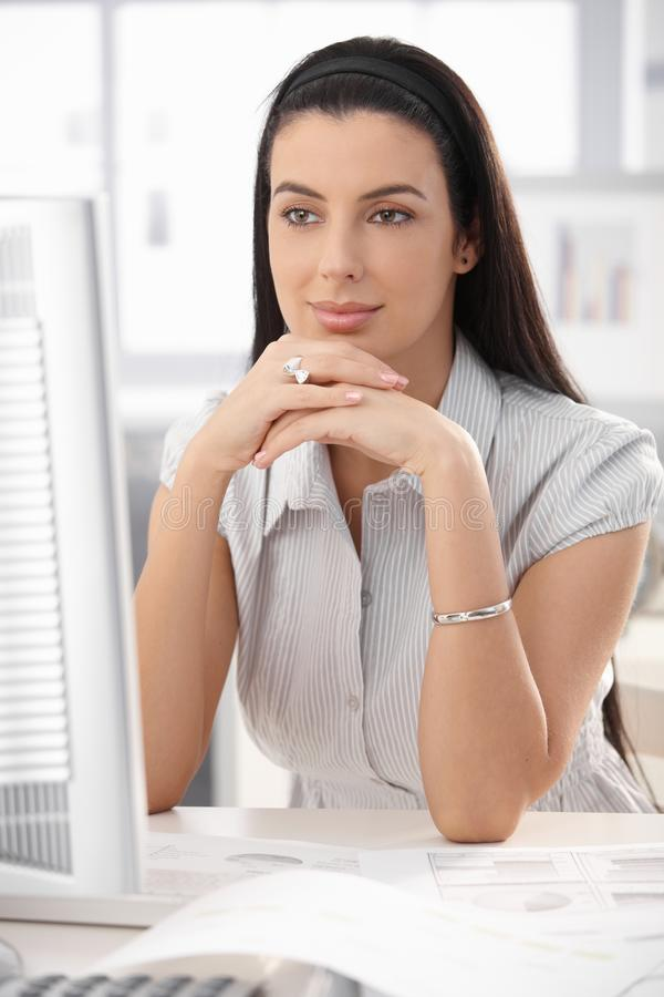 Download Portrait of woman at desk stock photo. Image of face - 18317684
