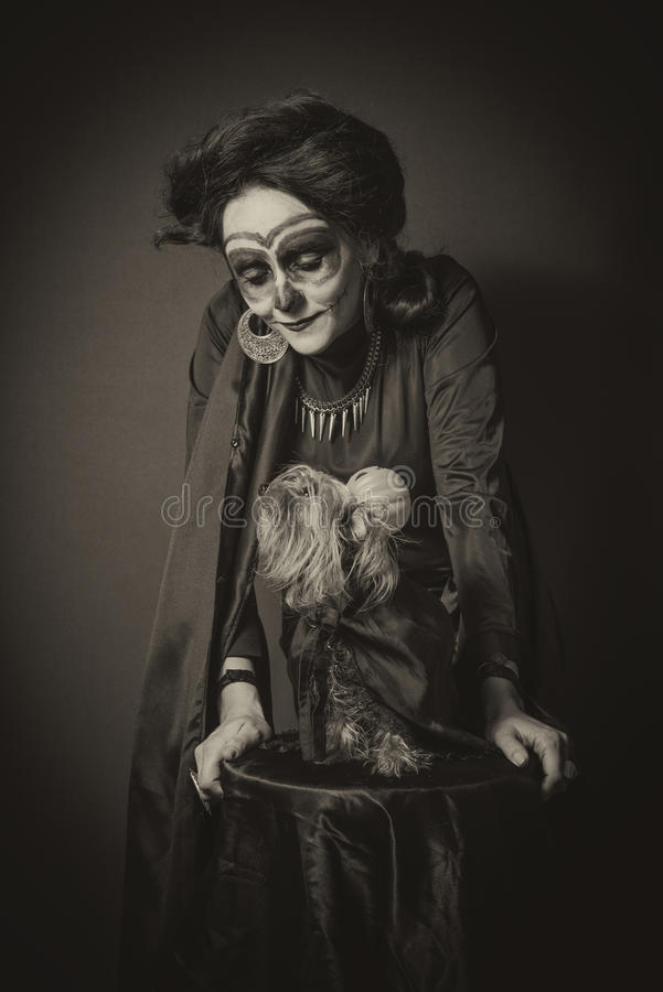 Portrait of woman and dog in disguise for Halloween royalty free stock image