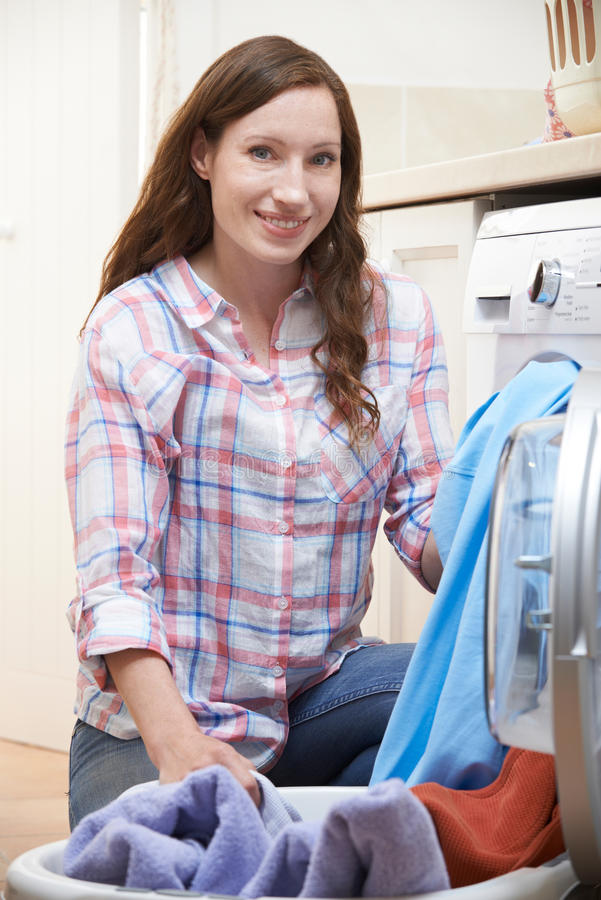 Portrait Of Woman Doing Laundry At Home royalty free stock photo