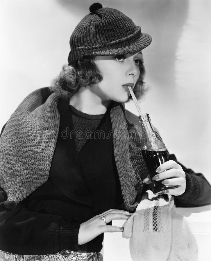 Portrait of woman drinking from bottle of soda royalty free stock images