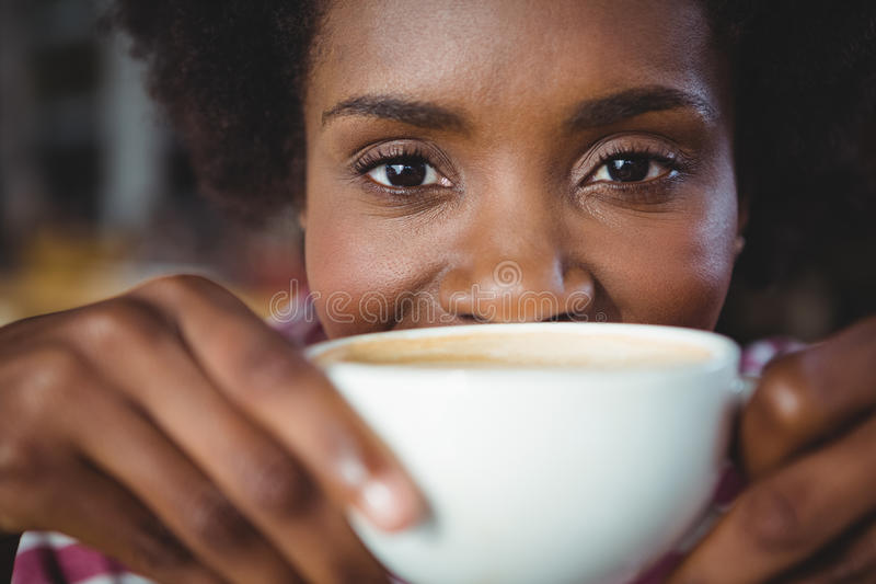 Portrait of woman drinking cup of coffee. In cafe royalty free stock images