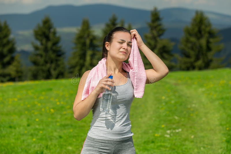 Portrait of woman drinking water outdoor.  stock photo
