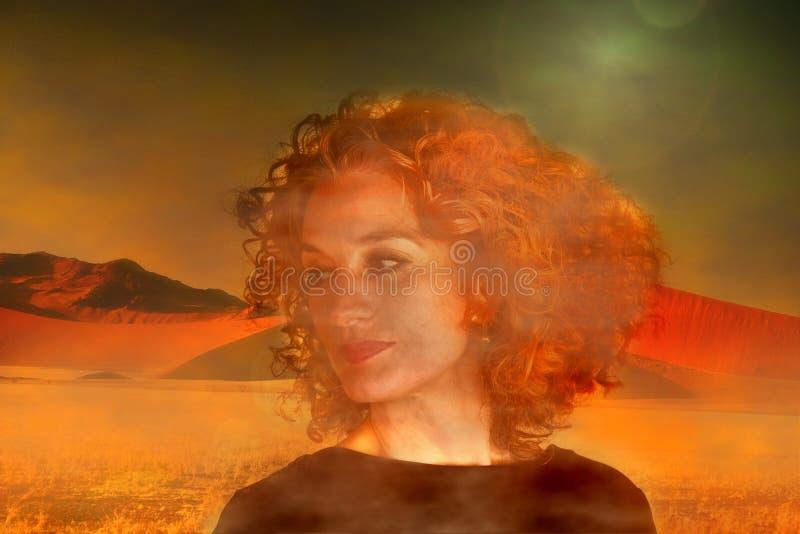 Portrait of a woman in early morning fog in the desert. Morning fog in the desert. In foreground the portrait of a red haired woman with wonderful curls