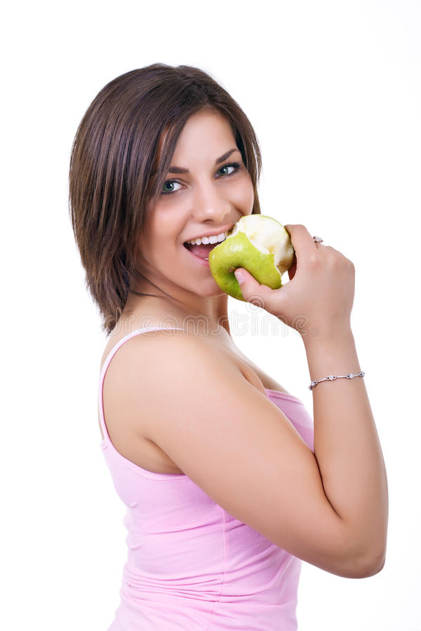Portrait of woman eating apple stock photo