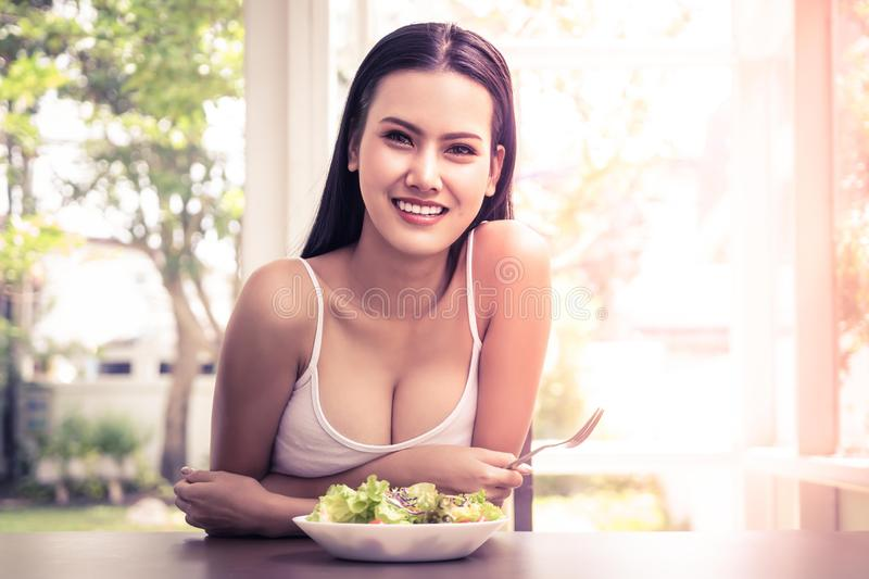 Portrait of a woman eating healthy vegetable salad for healthy and beauty lifestyle at home for healthy lifestyle royalty free stock image