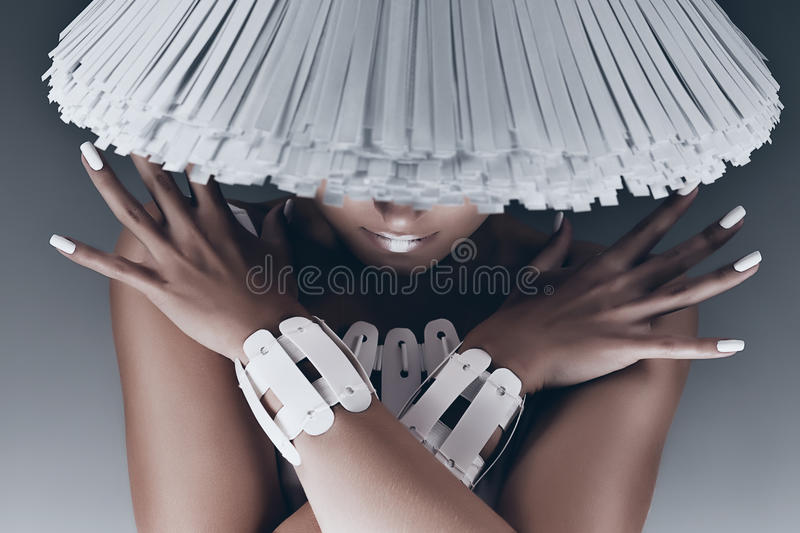 Portrait of woman with face under white hat royalty free stock images