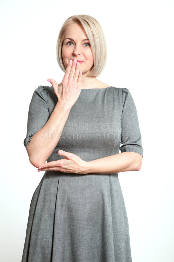 Portrait woman with finger on lips, or secret gesture hand sign isolated on white background stock photography