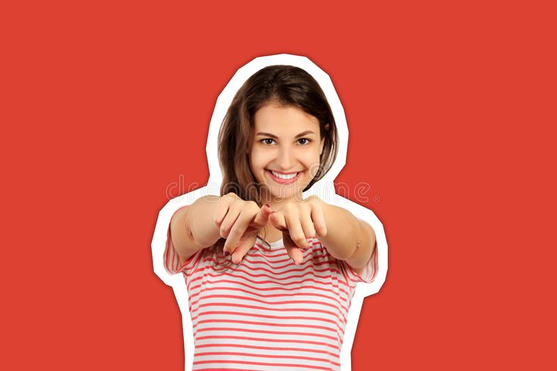 Portrait of woman finger pointing at camera. emotional girl Magazine collage style with trendy color background stock photography