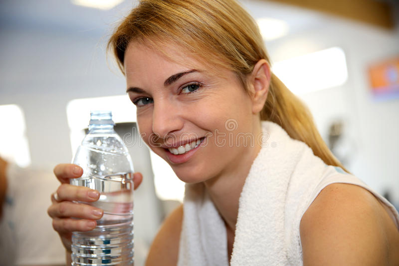 Portrait of woman in fitness center stock photo