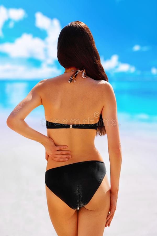 Portrait of woman flaunting her bottom in bikini.Sun Cream. Skin and Body Care. Sunscreen to Her Skin. Portrait Of Female Holding Suntan Lotion and stock image