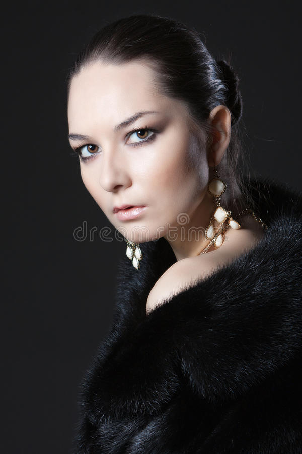 Portrait of woman in fur coat royalty free stock photos