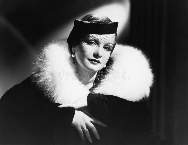 Portrait of woman with fur collar and hat with veil stock photo