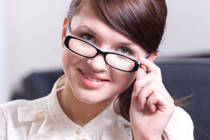 Portrait of the woman in glasses stock photo