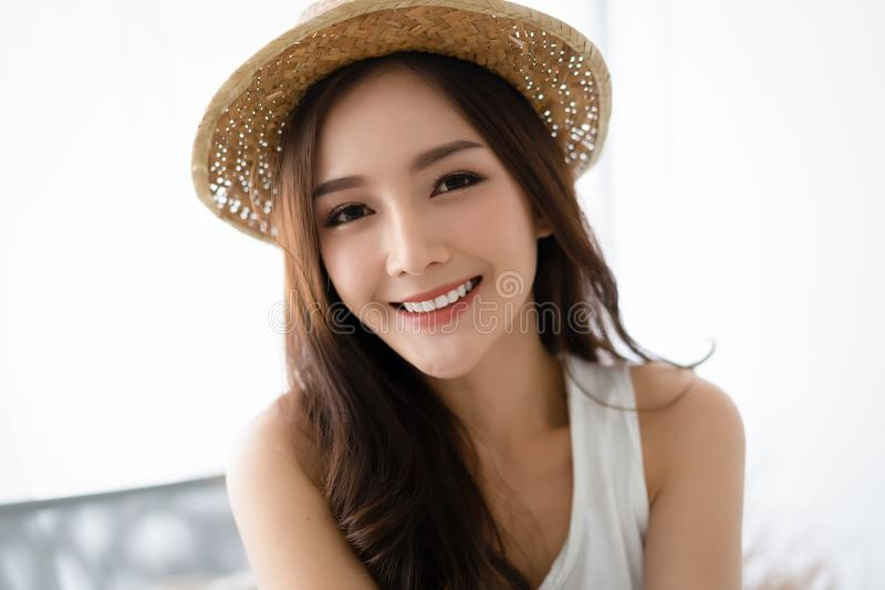 Portrait of a woman in a hat, closeup portrait of a nice female in summer straw hat and looking at camera.Concept woman lifestyle, royalty free stock photo
