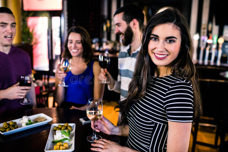 Portrait of woman having an aperitif with friends. Portrait of women having an aperitif with friends in a bar stock image