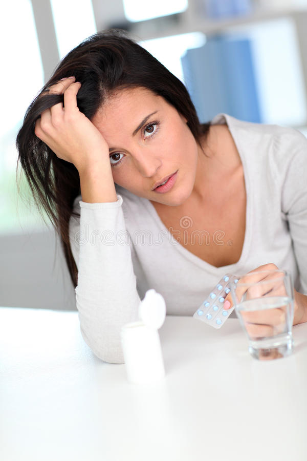Portrait of woman having a headache stock photography